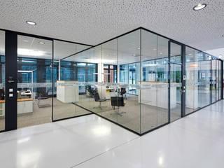 Büroräume rund um das Atrium:  Bürogebäude von ZENON CONCEPT GmbH