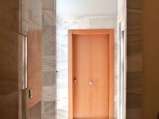 APARTMENTS DWELLING BUILDING Pasillos, vestíbulos y escaleras de estilo moderno de JoseJiliberto Estudio de Arquitectura Moderno
