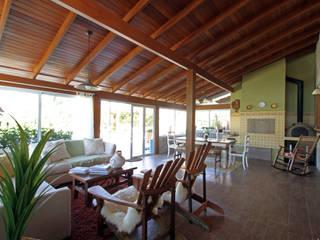 Nhà phong cách mộc mạc bởi Graça Brenner Arquitetura e Interiores Mộc mạc