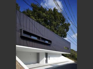 Casas modernas: Ideas, imágenes y decoración de 設計組織DNA Moderno