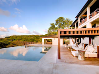 VILLA PRIVATA MUSTIQUE 1 Piscina in stile tropicale di ANG42 Tropicale