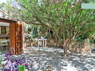 Garden Mediterranean style houses by ArchEnjoy Studio Mediterranean