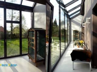 Ogrody zimowe: styl , w kategorii Korytarz, przedpokój zaprojektowany przez Alpina Design