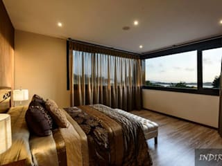 Спальня в стиле модерн от Indire Reformas S.L. Модерн
