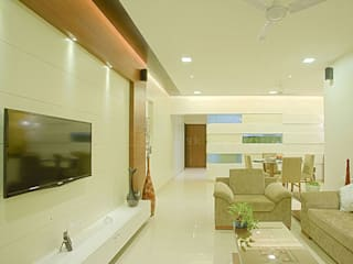 s k designs - contemporary residence in Andheri:  Living room by S K Designs