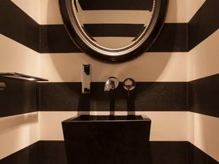 Aseo de Cortesía: Baños de estilo  de Magenta Interiorismo