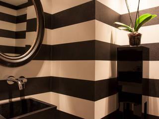 Aseo de Cortesia: Baños de estilo  de Magenta Interiorismo