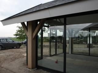 Verbouw stal bij boerderij:  Serre door Architectenbureau Jules Zwijsen, Modern