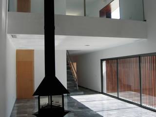 interiorismo: Salones de estilo moderno de Arquitectura e Interiorismo en Cadiz