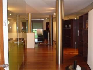Interno - Openspace: Ingresso & Corridoio in stile  di Mkstudio - Arch. Domenico Mariani & Gotthard Kerschbaumer