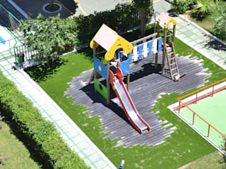Pavimentación ECO en Parque infantil de Studio3 Arquitectura/Paisaje/Urbanismo Minimalista