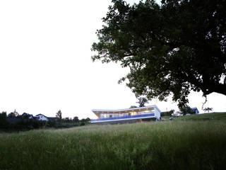 In der Landschaft: moderne Häuser von Kaltenegger und Partner Architekten ZT GmbH