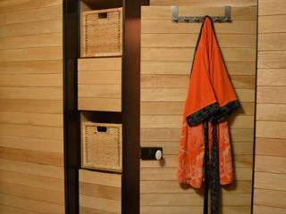 Aménagement de placards aux portes coulissantes:  de style  par Anaïs Martin