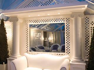 Particolare divano.: Giardino d'inverno in stile in stile Classico di Studio di Architettura Alberto Ambrosini