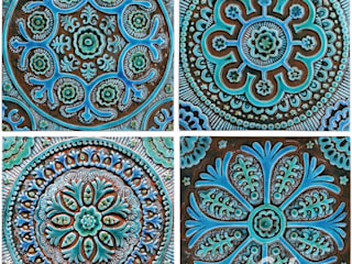 A group of four designs based on the Suzani fabric:   by Gvega Ceramica