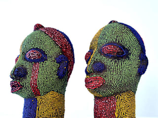 Pair of Nigerian Beaded Female Heads by The Moderns