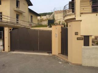 Portone e Cancelletto Case moderne di ENRICO MARCHIARO _ eMsign Studio _ Architettura_Interior Design Moderno