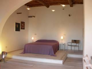 Casa per vacanze a Chiessi (Isola d'Elba) - Italy Camera da letto in stile mediterraneo di 70m2 Studio di architettura Mediterraneo