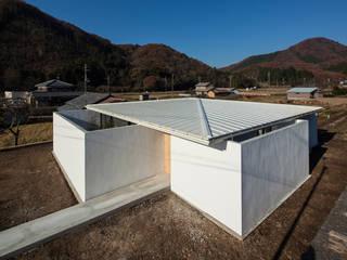 川添純一郎建築設計事務所 Case in stile minimalista