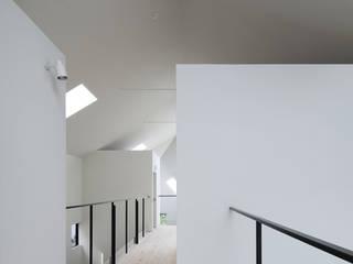 川添純一郎建築設計事務所 Ospedali in stile minimalista