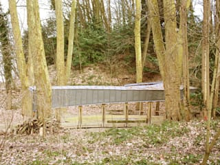 Vue de profil dans les bois:  de style  par H&G Hamelin&Groleau Architectes