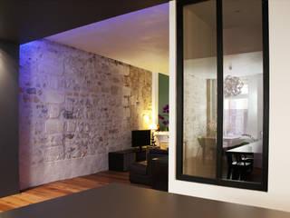 Modern living room by BIENSÜR Architecture Modern