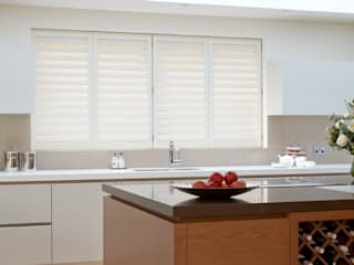 Kitchen shutters:   by The New England Shutter Company