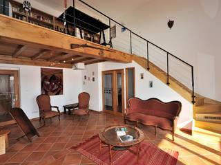 JOSE MARCOS ARCHITECTEUR Eclectic style houses