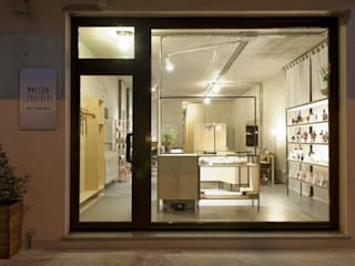 Industrial style offices & stores by Andrea Stortoni Architetto Industrial