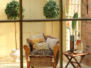 Conservatory by Deborah Warne Interiors Ltd,
