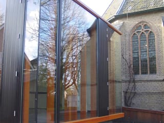 expansion of a historical church Linea architecten Modern style rooms