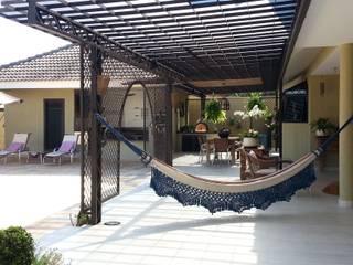 Balcones y terrazas de estilo rústico de CLÁUDIA FERRO ARQUITETOS ASSOCIADOS S/S Rústico