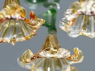 Glass chandelier with amber flowers:   by A Flame with Desire