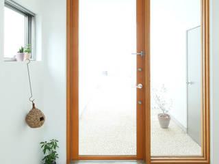 Trapezium House モダンな 窓&ドア の Kichi Architectural Design モダン