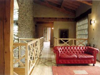 Recupero ex edificio residenziale a Broletto:  in stile  di Archimagica
