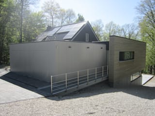 Extension en bois d'une habitation : Maisons de style  par Archi DVL