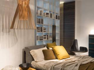 Showroom di Busto Arsizio Camera da letto moderna di Forme per Interni Moderno