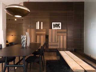 Showroom di Busto Arsizio Sala da pranzo eclettica di Forme per Interni Eclettico