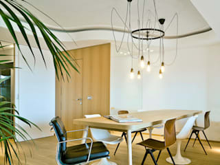 Eclectic style dining room by Manuel Ocaña Architecture and Thought Production Office Eclectic