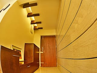 Apartment in Bangalore:  Living room by Creative Axis Interiors Pvt. Ltd.
