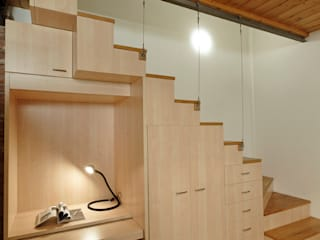 Modern corridor, hallway & stairs by Studio Arch. Matteo Calvi Modern