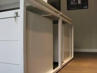 Allestimento uffici, Milano. Complesso d'uffici in stile minimalista di Abitudinicreative Minimalista