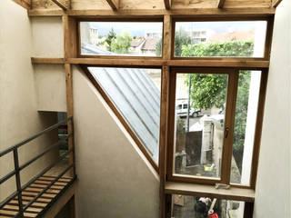 Maison S Fenêtres & Portes modernes par atelier eem Moderne