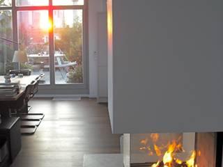 ofenmanufaktur. meisterbetrieb ห้องนั่งเล่นเตาผิงและของตกแต่ง