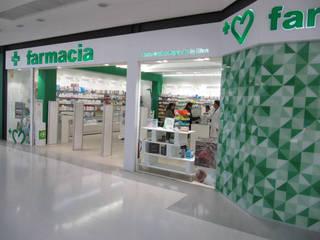 Farmacia Puga Málaga Oficinas y tiendas de estilo mediterráneo de Panatta Diseño Comercial Mediterráneo