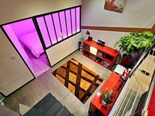 Dégagement chambres: Couloir et hall d'entrée de style  par Cabinet Dario