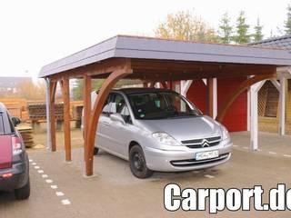Carport mit Leimholzbogen und Walmblende von Schmidtke & Co. Holzveredlung GmbH Klassisch