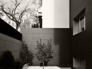 CIVITASNOVA - Vista del patio: Casas de estilo  de CIVITASNOVA