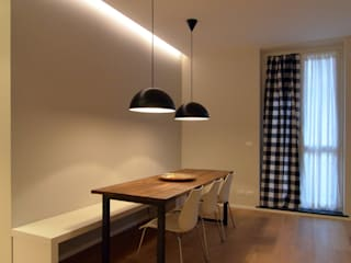 Minimalist dining room by ministudio architetti Minimalist