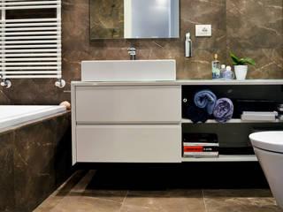 Baños de estilo  de Studio Sabatino Architetto